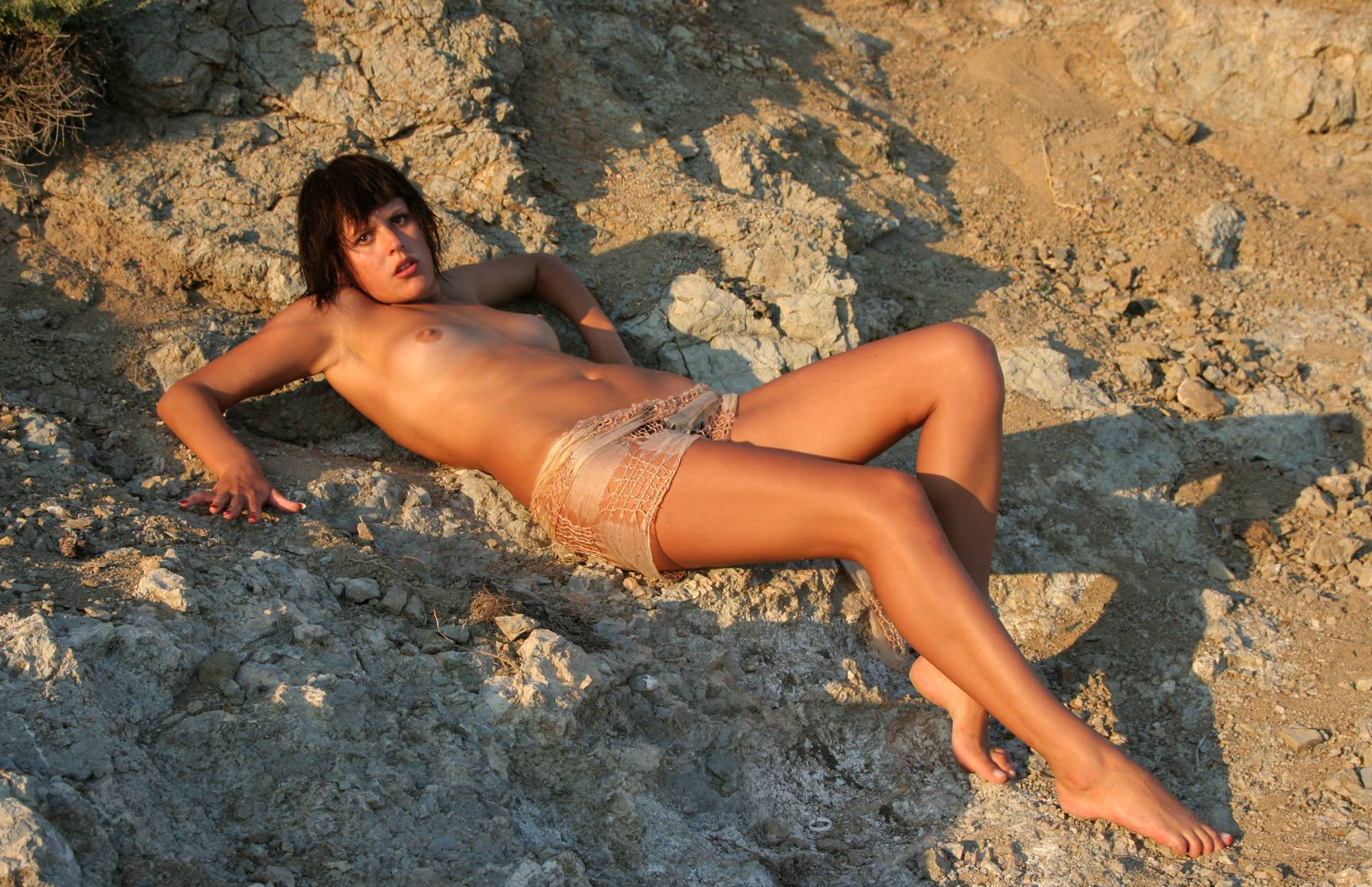 Nudist Pictures Against Rocky Backdrops - 1