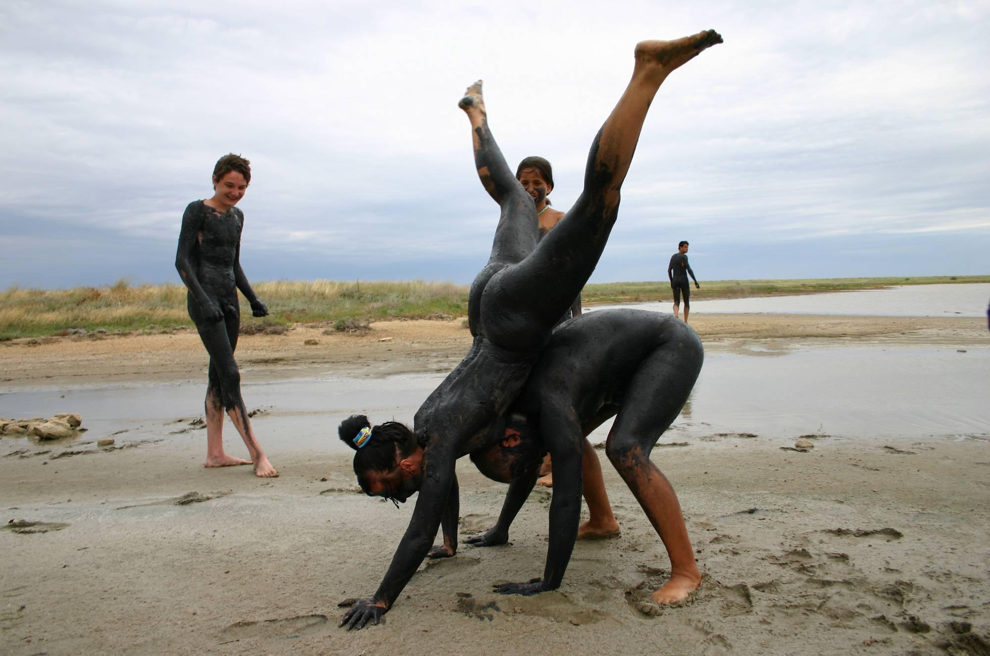 Nudist Gallery Black Mud-Paint Couples - 1