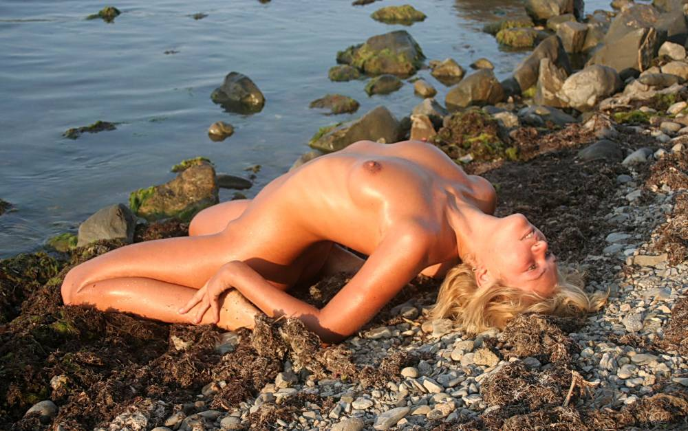 Nudist Pics Laying On Some Pebbles - 1