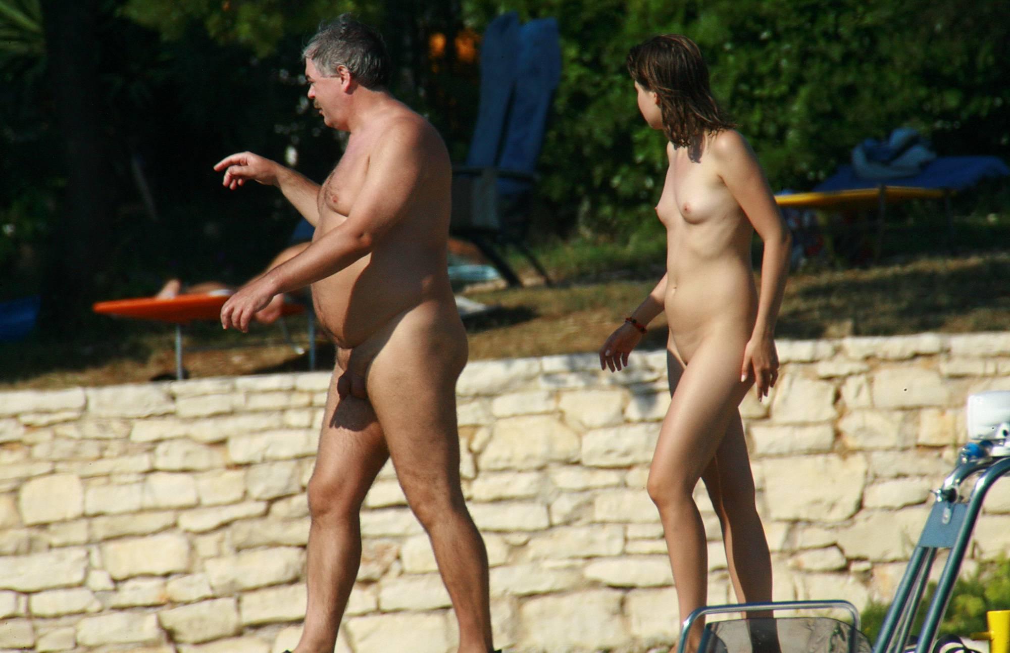 Nudist Pics Strolling On The Veranda - 1
